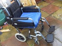 FOLDING WHEELCHAIR IN VERY GOOD CONDITION HAS BRAKES, SEAT BELT AND SPECIALIZED CUSHION CAN DELIVER