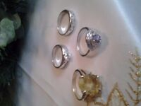 £25 for all 4 solid silver rings with stones in them and one large stone stamped 925
