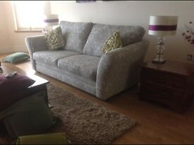 This sofa has barely been sat on and when it was not without a throw so is in immaculate condition