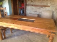 Dining Room Table and 6 Chairs. Solid Wood. With wrought iron feature