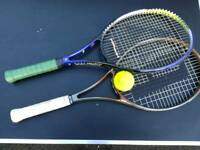 2 tennis rackets and ball