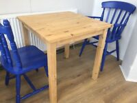 Solid wood square 4 person dining table. Very good condition.