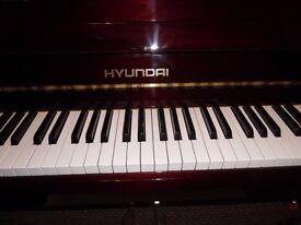 upright piano by hyundai-- showroom--