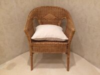 Cane/wicker casual captain's chair.