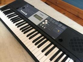YAMAHA PIANO KEYBOARD includes stand for the keyboard, plug and music reader stand,
