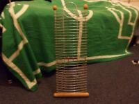 Wooden and metal CD or DVD rack. Holds 30 CD/DVDs.