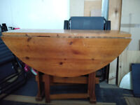 Solid Wood Round Kitchen Table with Drop Leaves. Comes with 5 tableclothes and protector.