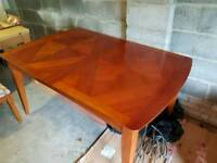 Extendable dining room table and 6 chairs.