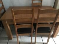 Extendible oak style dining table and 6 chairs