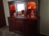 Beautiful dark wood sideboard with wood and glass top display cabinet and inset lighting.