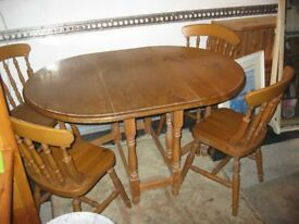 SOLID PINE DUAL DROP LEAF TABLE WITH 4 ORNATE PINE FARMHOUSE CHAIRS. VIEWING/DELIVERY POSSIBLE