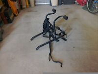 Twin cycle rack for a saloon or hatchback car
