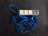 Electric hook up cable with safety trip for caravan/tent
