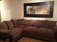 Brown Corner Sofa (DFS) with scattered cushions