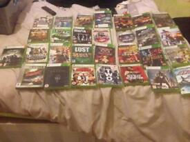 Xbox360 slim and 59 games on disc as well as 24 on console