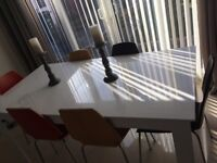 White gloss extendable dining table seats 6-8 bought from Leekes