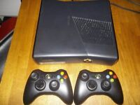 XBox 360 Slim 250gb. 2 x Controllers. Guitar and 10 games.