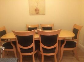 Extenable dining table 4 chairs and 2 carvers