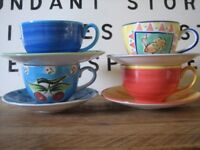 Cup and saucers. Set of 4 by Whittards of Chelsea. Hand painted designs. Gorgeous colours.