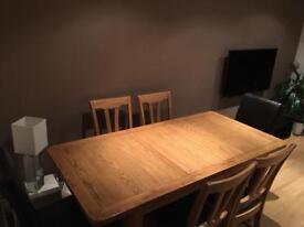Table and 4 oak chairs plus 2 faux leather chairs