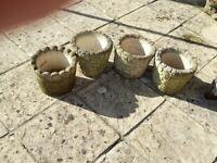 Four sandstone pots