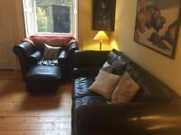 Used triple seater sofa, huge arm chair & foot stool.