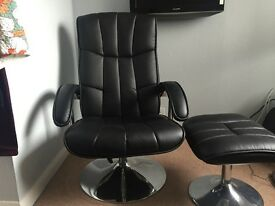 Black faux leather reclining chair and stool.