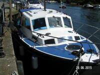 Boat for sale. Aquabell 27. 27' two berth work boat. Merc inboard engine.