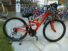 OLDER CHILDS APOLLO FS24 BIKE 24 INCH WHEELS 18 SPEED FULL SUSPENSION RED GOOD CONDITION