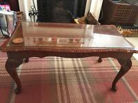 Glass top coffee table with Queen Anne legs