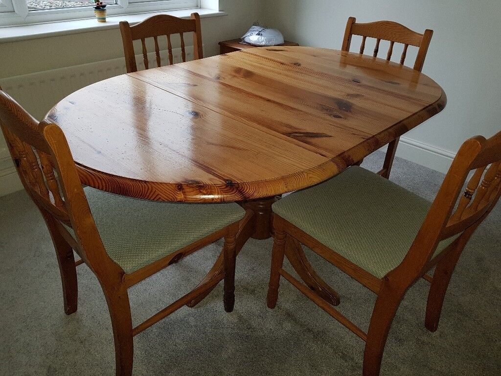 dining room pine table including 4 chairs  in uckfield