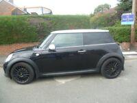 2011 mini,cooper metalic black low miles fantastic condition