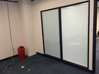 Glazed office partitions double glazed with Venetian blinds. Attractive blue frames
