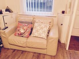 Cream two setter leather sofa