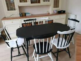Unique hand painted dining table and 6 chairs.
