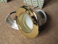 4 Click Polished Brass R63 Downlights with new bulbs. Brand new. Plus 4 60W R63 Reflector Bulbs.