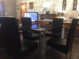 Black glass n Crome dining table n 4 chairs