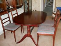 Beautiful solid wood dining room table with 6 chairs....NOW REDUCED!