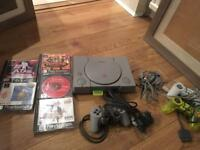 Original PlayStation for sale with spare controllers and a few games