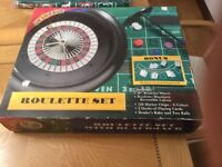 Roulette set +a table top roulette layout
