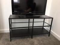 IKEA black TV stand with glass shelf