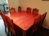 Oregon Pine Dining table and 8 chairs.
