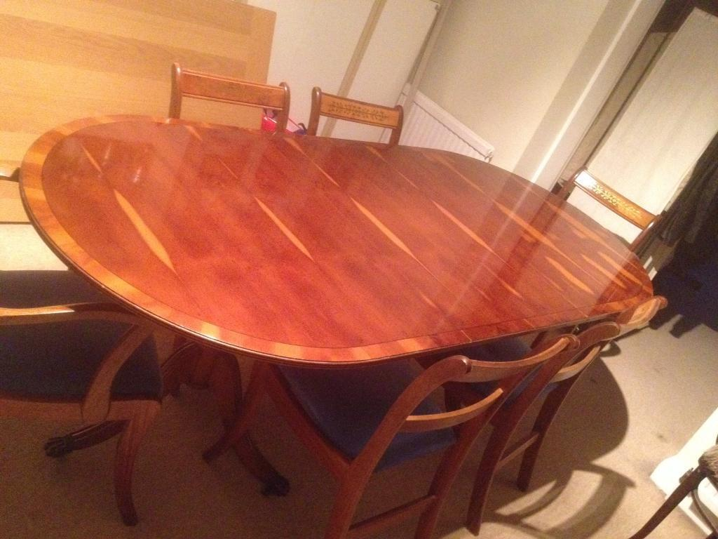 Extending yew wood dining table &six chairs