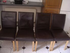 4 Brown leather dining room chairs