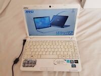 Pink and White MSI U230 series Notebook/ laptop