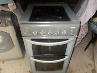 HOTPOINT GAS COOKER - GRAPHITE GREY WITH SMOKED GLASS SAFETY LID - IN CONINGSBY