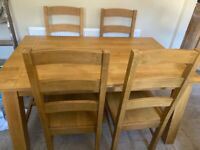 Solid Oak Dining table & 4 chairs.