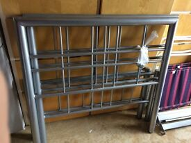 Two metal single beds
