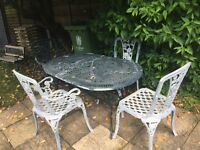 Cast iron garden table and four chairs