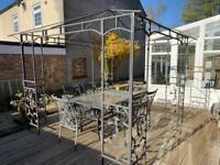 Garden pergola / gazebo with table and chairs